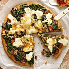 This veggie-packed pizza recipe features broccoli rabe, garlic, mushrooms, and sweet golden raisins. Melty ricotta cheese adds a savory finish. More pizza recipes: http://www.bhg.com/recipes/healthy/dinner/heart-healthy-pizza-recipes/ #myplate