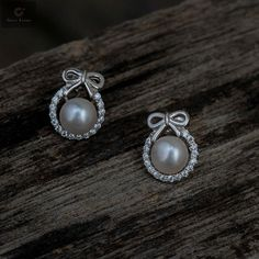 Flaunt basket presents Pearl Studs made of pure 92.5 sterling silver with Zirconia Stones. Amazing finish, perfect for any occasion and good build quality. #silver #puresilver #pearl #Studs #925sterlingsilver #925silver #jewellery #fashion #silverjewellery #pearls #pearljewellery #zirconiastones #silverstuds #beautifulearrings #silverstore #pearlearrings #silverornaments #pearlstuds #earringswithpearls #stonedearrings #earringswithstone