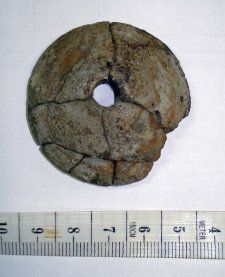 Excavated/Findspot Lilleberge, long barrow (scope note | all objects), Norway.   9th century C.E.  Material: siltstone.  Diameter: 4.43 centimetres Thickness: 1.17 centimetres