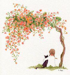Fillette et son chat sous un arbre fleuri