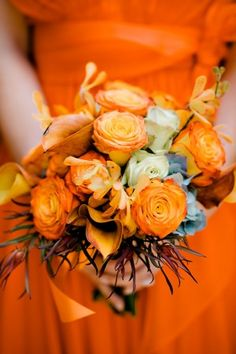 Orange bridesmaids bouquet | http://www.bound-by.com/: lovely colors for a fall or winter wedding!