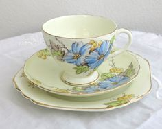 Vintage cup, saucer, plate, Foley china, E Brain and Co, Begonia pattern, blue flowers, yellow and green touches, footed cup, trio, 1936-48 by CardCurios on Etsy