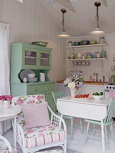 Beadboard Breakfast-Nook  Floral prints, pastel paints, and white-beadboard walls give this country kitchen vintage charm.