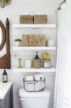 After they re-sheetrocked the walls, the couple installed inexpensive, faux shiplap on top and painted the entire room white. Rachel cleverly chose paint with a satin-finish so that light entering the (Diy Bathroom Storage) Country Bathroom Decor, Shelves, Small Bathroom Decor, Shelves Above Toilet, Small Bathroom, Apartment Decor, Simple Bathroom, Easy Bathroom Organization, Bathroom Inspiration