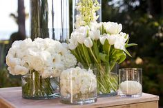 Ranunculus, tulips, and orchids add interesting textures to an all white wedding centerpiece @Four Seasons Hotel Baltimore
