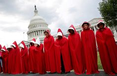 Women demonstrate outside the US Capitol in Washington on June 27 against cuts to Planned Parenthood proposed by the Senate Republican health care bill. They dressed as handmaids from the novel and adapted television series The Handmaid's Tale, which is set in a dystopian world where women's rights are severely curtailed..