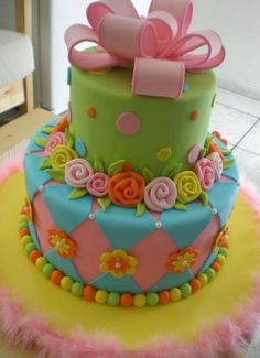 Cool colourful cake. Diamonds, roses, spots and a ribbon on top.