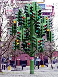 Fake - It's a Sculpture - This bit of public art blends nature with traffic in one confusing sculture. It's Pierre Vivant's Traffic Light Tree. A giant sculpture of fully-functioning traffic lights in London. For some reason it's parked next to a roundabout near Canary Wharf.  It was created by the Public Art Commissions Agency and it's sure to confuse tourists, since roundabouts are confusing all by themselves.The light cycles of the Tree/Traffic Light mimic the action of  Canary Wharf.