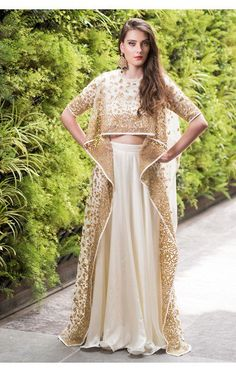 Ivory high low cape with ivory satin skirt Cape Lehenga, Lehenga Skirt, Pink Lehenga, Bridal Lehenga Choli, Jacket Lehenga, Lehenga Wedding, Indian Dresses, Indian Outfits, Indian Clothes