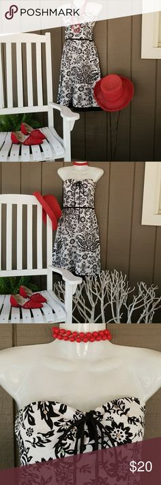 Speechless dress Speechless black and white floral print dress.  Can be worn as a halter or strapless.  It has a black band around the waist line and zips up the side. Red is a great accent color and a jacket will take you into fall.  There are sequins throughout the fabric. Also has a built-in bra. Speechless Dresses Strapless