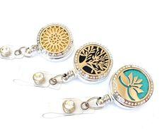 Essential Oil Diffuser Badge Reel - Aromatherapy Name Badge Holders - Locket Badge Clip - Retractable Badges - Nurse Jewelry - BadgeBlooms by BadgeBlooms on Etsy https://www.etsy.com/listing/387026962/essential-oil-diffuser-badge-reel
