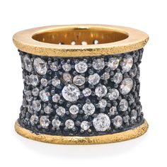 Free Ground Shipping and Free Returns. DETAILS: Gunmetal ring with gold plated center and CZ stones. Size 5 only.