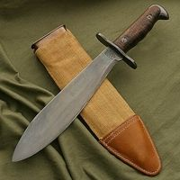 """US Model 1917 Bolo Knife w/ Scabbard  These knives were used in the Central American """"Banana Republic"""" campaigns of the 20's and 30's and saw action in the trenches of WWI and Pacific Theatre in WWII. A compact but effective chopper for digging, clearing brush and as a close Quarters Combat weapon if needs be."""