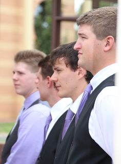 Photos from my wedding Groomsmen wore black pants and vest, white shirt and purple tie Groom wore a grey vest & pants, purple shirt and silver tie!