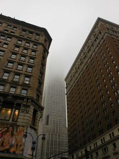 Empire State Building disappearing into the sky.
