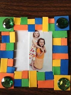 VBS Babylon Mosaic Shop. The box was too expensive so I am making  Popsicle stick frames and pre cutting squares of foam with the adhesive backing.  We will take pictures on the first day, have them developed at Walgreen and be ready to put a picture of a child in each frame!
