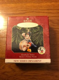 Hallmark ornament Bandleader Mickey is #1 in the Mickey's Holiday Parade series. The ornament is in excellent condition. The box has a dent on the front and the back at the top. There is a scuff mark on the back of the box. You really can't see the dent on the front of the box in the picture. All reasonable offers are considered. Ornament will be packaged securely for safe shipping. Hallmark Christmas, Hallmark Ornaments, Hallmark Homes, Seasonal Decor, Badge, Box, Holiday, Pictures, Photos