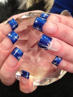 Blue french tips with stars.