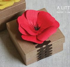 Wrap beautiful packages with this easy DIY tutorial for making paper flowers