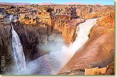 At the Augrabies Falls the Orange River drops 191 metres. The Augrabies Falls National Park is an hour from Upington. Augrabies Falls, South Africa, Grand Canyon, Places To Go, Things To Do, Waterfall, National Parks, Wildlife, River