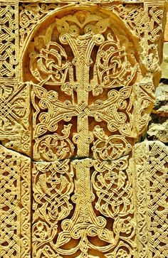 Khachkar (Armenian cross-stones). The most common khachkar feature is a cross surmounting a rosette or a solar disc. The remainder of the stone face is typically filled with elaborate patterns of leaves, grapes, pomegranates, and bands of interlace. Occasionally a khachkar is surmounted by a cornice sometimes containing biblical or saintly figures. Khachkars, their symbolism and craftsmanship are inscribed in the UNESCO list of Intangible Cultural Heritage.