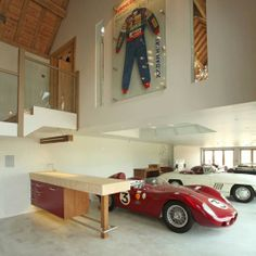 COTSWOLDS HQ by Splinter Works in Central England, UK. A stone barn transformed into an executive suite and a place to house the client's classic car collection.