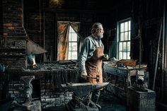 The Blacksmith photograph by Gary Heller Photography A Blacksmith in his shop, back to the raging forge as he looks out the window to see who has come by. #blacksmith #forge #metalsmith #ironworker #smith #farrier #photography