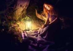 A beautiful scenery of a woman in the forest by lamplight. (If anyone knows the original source please tell me so I can credit. <3 )