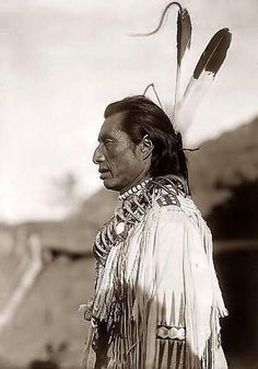 """""""Crows Heart"""",  Indian Brave wearing a bear claw necklace. 1908 by Edward S. Curtis on Flickr."""
