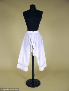 Lady's cotton and lace drawers, 1866; Tabby cotton with split crotch, leg hems trimmed with tucks, eyelet embroidery and handmade linen lace insertions, drawstring tie, sewn with chain stitch machine