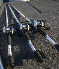 3 CarbonLite rods on the deck of a bass boat.