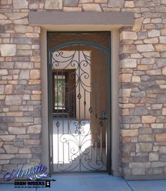 Wrought iron entry gate with scrolls and birds nest