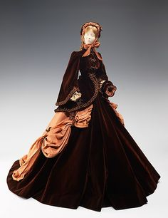 """""""1866 Doll"""" with costume designed by Marcelle Chaumont in 1949 as part of the Friendship Train.  The inspiration for this doll came from a painting by Winterhalter. Franz Xaver Winterhalter (1805-1873) was a German painter best-known for his royal portraiture. His most well-known works include portraits of Empress Eugénie and Empress Elisabeth of Austria."""