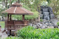 Gazebo built up on posts with large umbrella like roof extending well beyond the dimension of the gazebo platform