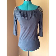 "Anthropologie Deletta Gunmetal Gray Beaded T-Shirt Beautiful long sleeve top with beaded accents on the shoulders from Anthropologie brand Deletta.  Very soft and lightweight with a flattering pleated bust area.  Color is a very deep ""gunmetal"" gray - almost a blue undertone. Condition: EUC - free of rips, stains, odors.   Material: 100% cotton Size: Small Pit to Pit: 20"" unstretched Waist: 30"" Length: 25"" Sleeve Length: 18"" Anthropologie Tops Tees - Long Sleeve"