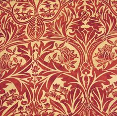 Bluebell Curtain Fabric A floral print in claret red with a mottled effect to give it an aged look.