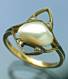 An Art Nouveau gold, enamel, pearl and diamond ring, attributed to E. Guilbert, French, circa 1900. Marked E G with a bodkin. #Guilbert #ArtNouveau #ring