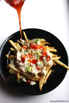 A mouth watering mashup of two classic recipes - crab rangoon poutine. The homemade fries are easier than you think and well worth it! #food #yummy #delicious