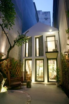 in vietnam, nghia-architect has completed 'maison T', a compact house in a typical hanoi alley that presets a perforated brick façade to the passing street. Cabinet D Architecture, Architecture Design, Interior Exterior, Exterior Design, Landscape Arquitecture, Concrete Bricks, Compact House, Two Storey House, Small Courtyards