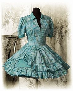 Wonderful fresh looking fabrics for a springtime dance.  The narrow v-neck and collar draw attention toward the face.  Make sure the colors used are flattering when they are this close to your face.  The skirt is from an Authentic pattern.  Don't attempt this skirt if you have no patience for gathering ruffles.