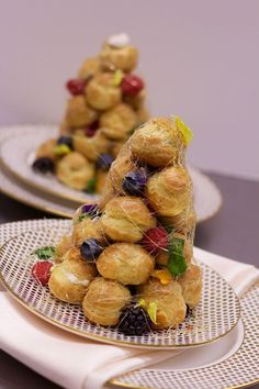 Mini Croquembouche towers are so pretty you almost don't want to eat it! Dazzle your party guests with this colorful dessert!  #peppersfinecatering