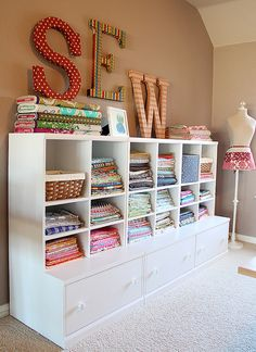 Fabric Storage by craftapple, via Flickrbolts on top- yardage folded on shelves, 1/2,1/4 folded in sight in stacks and scraps in the drawers- I can see it!