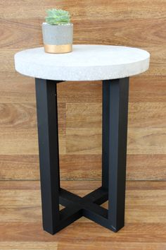 Round concrete top, grinded back to showcase our signature riverstones •Stained 4 leg timber base, featured a crossover base •Table Top Diameter: 37cm •Height: 50cm  All products are handcrafted in Australia. Slight variations in colour and texture may occur, giving each piece its own unique character.