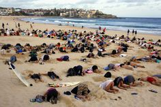 "A group of around 400 demonstrators participate in a protest by burying their heads in the sand at Sydney's Bondi Beach, November 13, 2014. Hundreds of protesters participated in the event, held ahead of Saturday's G20 summit in Brisbane, which was being promoted as a message to Australian Prime Minister Tony Abbott's government that, ""You have your head in the sand on climate change""."
