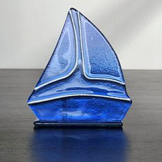 Glass Sailboat Tea-Lite Holder     List $7.99   SKU 115138   3 inches wide x 5.5 inches long x 5 inches high