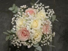 Bridesmaids' bouquet of roses and gyp