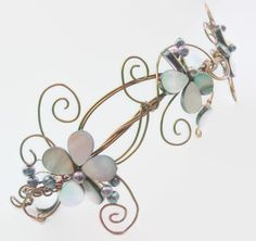 Whimsical bridal floral hair vine via TiarasAndTeirs. Click on the image to see more!