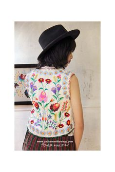 batik amarillis's folklore vest 4 Available at Batik Amarillis webstore www.batikamarillis-shop.com A vintage waistcoat vest inspired features Hungarian's meticulous, colorful & intricating embroidery style on raw tenun gedog Tuban with batik gedog piping