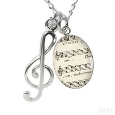 Sheet Music and Treble Clef Necklace. #musicfashion http://www.pinterest.com/TheHitman14/hey-ladies-coolmusicfashion/