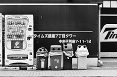 These are not the droids your looking for...Four recycle bins and a vending machine in Tokyo's Ginza district.